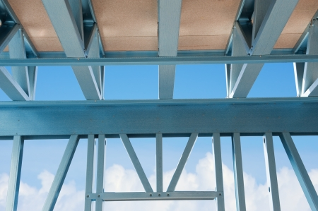 New residential construction home metal framing  against a blue sky Stock Photo