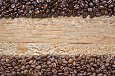 coffee beans background from two different kind of coffee on the old wooden table photo