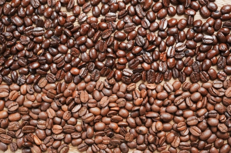 robust: coffee beans background from two different kind of coffee on the old wooden table