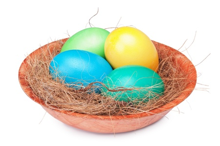 multicolored Easter eggs  in a nest isolated on a white background  photo