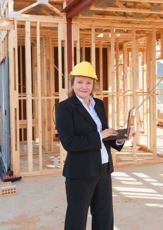 female engineer with laptop at the construction site   photo