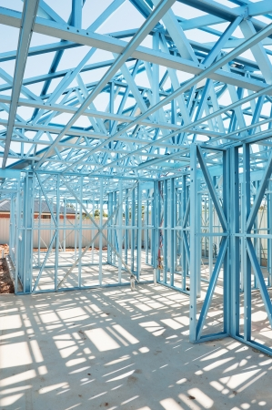 stud: New residential construction home metal framing  against a blue sky Stock Photo