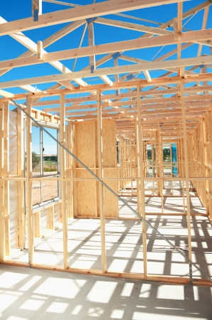 New residential construction home wooden framing against a blue sky Stock Photo - 19109176
