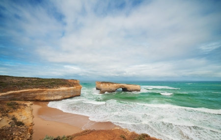 Famous rocks London Bridge in the rain,Great Ocean Road, Australia photo