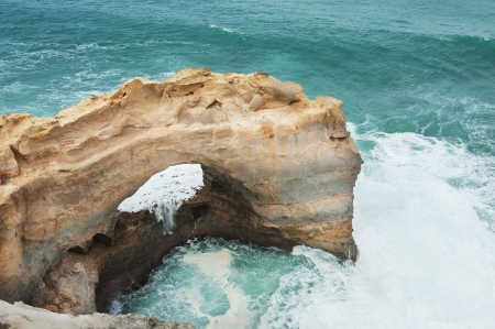 coastal erosion: Famous rocks The Arch ,Great Ocean Road, Australia
