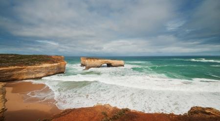 Famous rocks London Bridge in the storm weather,Great Ocean Road, Australia photo
