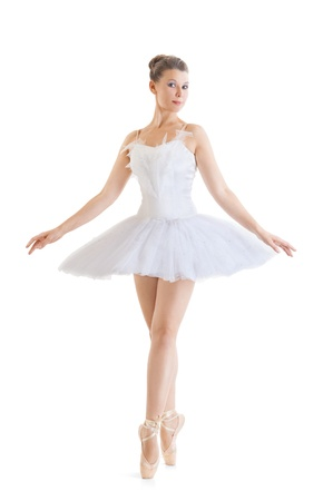 beautiful ballerina in classical tutu on a white background