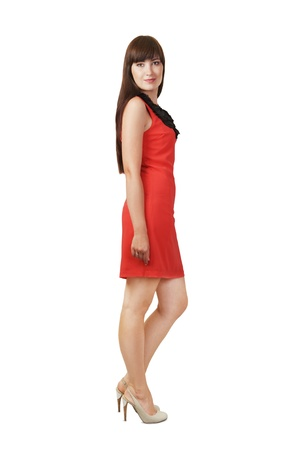 Beautiful young woman wearing red dress isolated on white photo