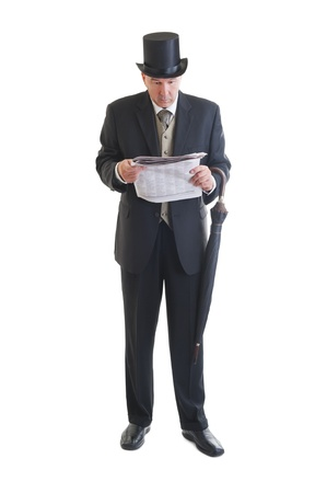 journals: Middle aged  businessman in a retro business suit with newspaper and umbrella isolated on white.