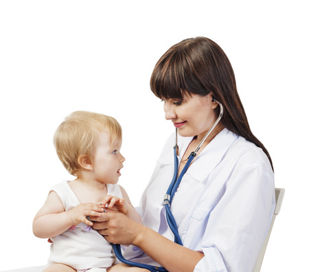 Pediatrician woman doctor with baby girl patient on white background photo
