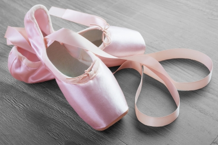 training shoes: new pink ballet point shoes on vintage wooden