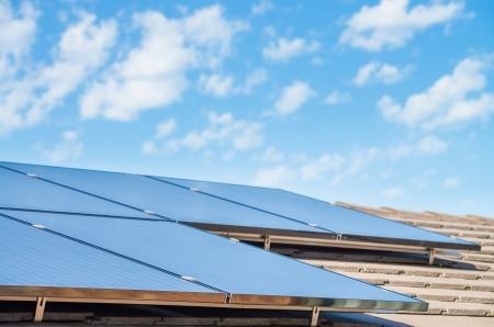 solar array: new solar panels on the roof of modern suburban house Stock Photo