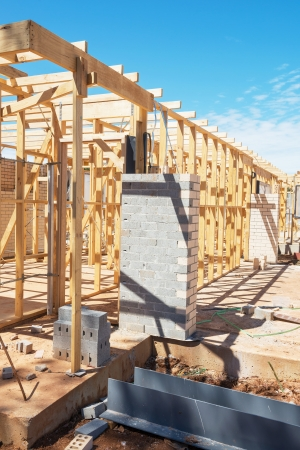 New residential construction home framing against a blue sky. Stock Photo - 24524125