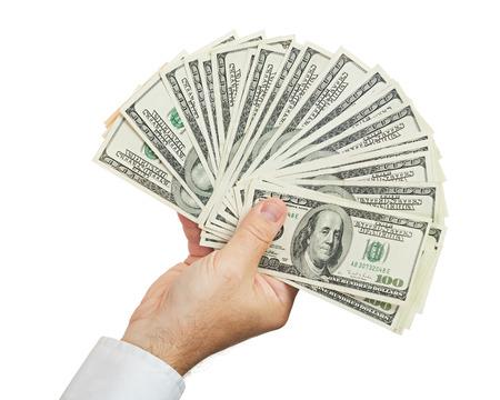 hand of businessman holding money isolated on white background photo