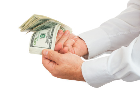 hands of businessman holding and counting money isolated on white background photo