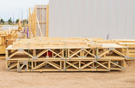joists: stack of wooden joists and building lumber at construction cite
