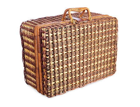 vintage wooden wicker suitcase isolated on white background  photo