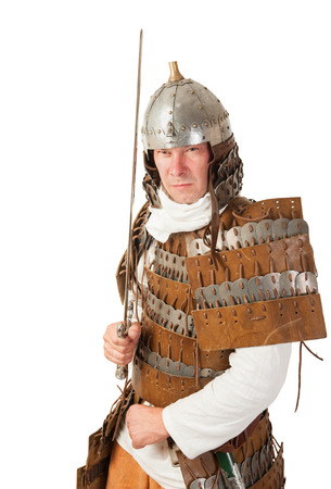 medieval warrior man wearing in ancient armor with sword photo