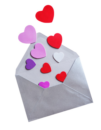 Envelope with foam shapes hearts for valentine day on white background  photo
