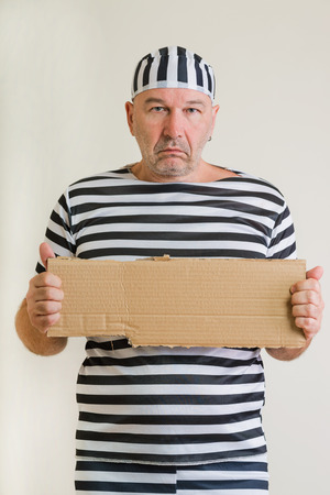 portrait of a man prisoner in prison garb Stock Photo