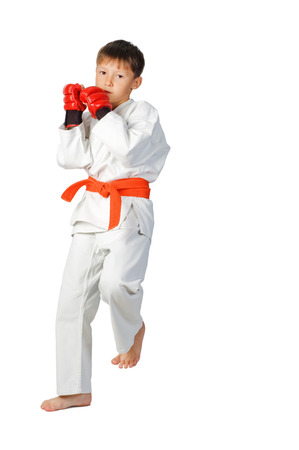 young boy aikido fighter in white kimono showing martial arts isolated on white  photo