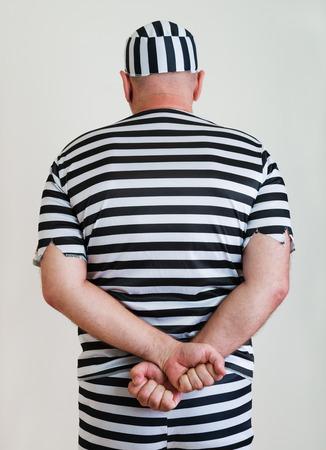 portrait of a man prisoner in prison garb Stock Photo - 27364744