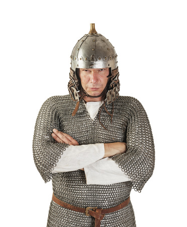 medieval warrior man wearing in ancient armor on white photo
