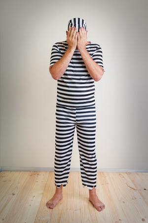 portrait of a man prisoner in prison garb photo