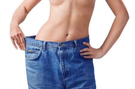 body care: Girl showing how much weight she lost  isolated on white