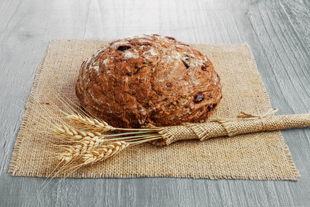 sour cherry: loaf of  sour cherry and walnut rye bread on wooden background  Stock Photo