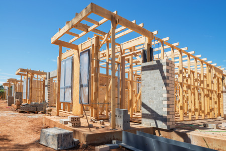 house property: new suburban homes currently under construction in row
