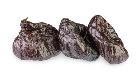 pitted: Dried pitted Prunes isolated on a white background