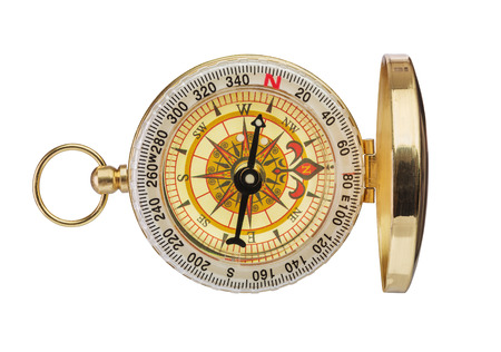 traverse: Retro brass compass isolated on white background