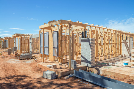 residential home: new suburban homes currently under construction in row Stock Photo