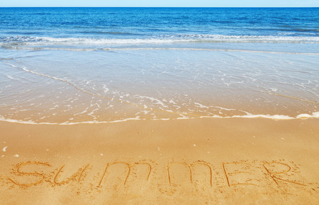 sea mark: Summer message on the beach sand - vacation and travel concept