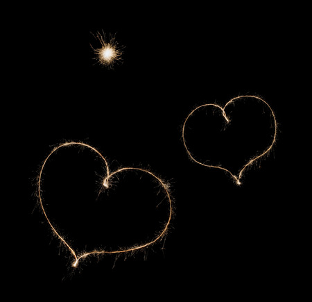 star shaped: two hearts from sparkler  on black background