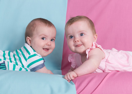 Beautiful twins on pink and blue.Brother and sister 스톡 콘텐츠
