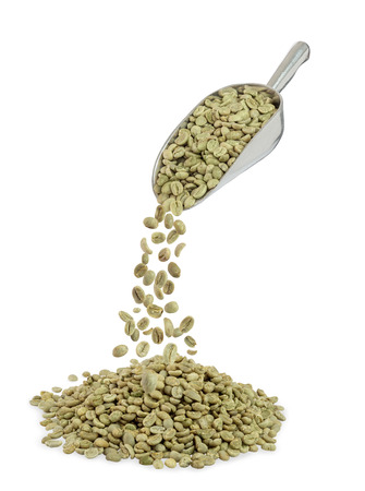 heap of green coffee beans and metal scoop isolated on white