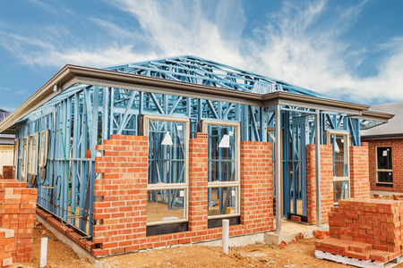 residential home: New residential construction home from brick with metal framing against a blue sky Stock Photo