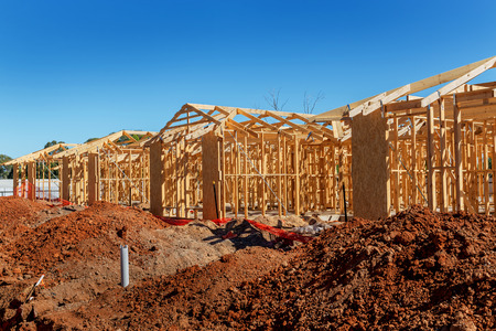 building site: new suburban homes currently under construction in row Stock Photo