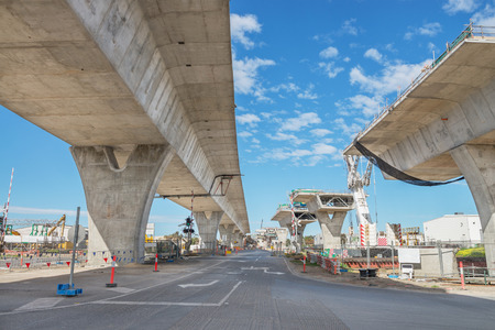 overpass: road currently under construction at several levels to increase traffic