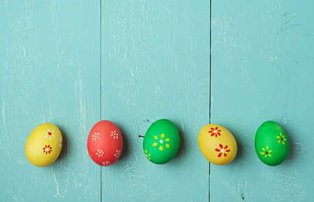 craquelure: multicolored easter eggs on vintage painted wooden background with craquelure Stock Photo