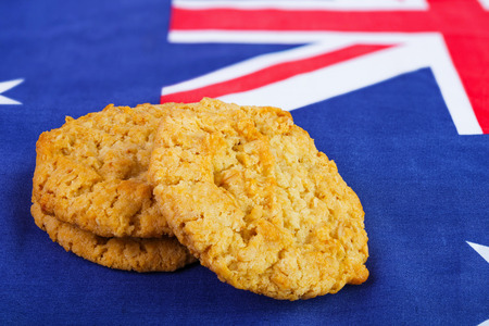 anzac: Traditional  Anzac biscuits on  Australian flag as background