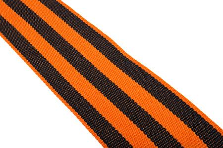Black and orange Ribbon of St. George isolated on white background photo