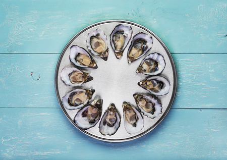 dozen: dozen fresh oysters on special cooking and serving metal tray