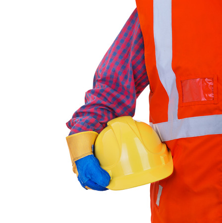 safety at work: Safety Protective Work Equipment.Worker in orange vest holding yellow helmet isolated on white background