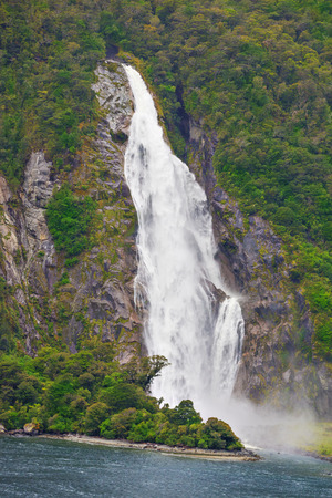fiord: Waterfall of Milford Sound fiord,  Fiordland National Park, New Zealand,wind and weather