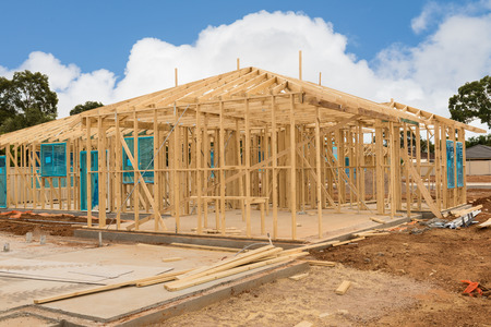 wooden joists: view of construction site house foundation and new home framing in preparation process Stock Photo