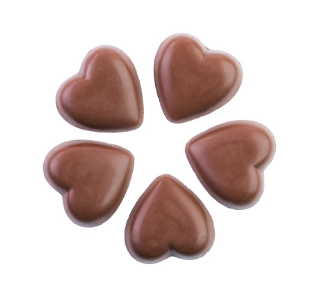 love shape: Real dark chocolate hearts isolated on a white background Stock Photo