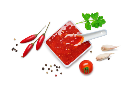 spicy chilli: red hot chilli sauce  isolated on a white background.Top view Stock Photo